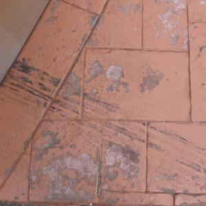peeling paint on a stamped concrete driveway